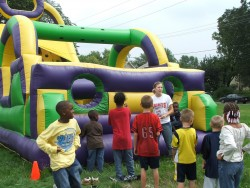 Photo of children playing with inflatable games.