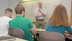 Photo of John August speaking to class.