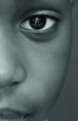 photo of child with MLK face in eye