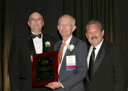 photo of Rick Morrow, 2007-08 IPA President Jay Currie, and Tom Temple, IPA's executive vice preside