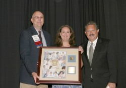 photo of Anisa Fornoff (middle), 2007-08 IPA President Jay Currie, and Tom Temple, IPA's executive v