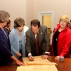 President David Maxwell and Madeleine Maxwell sign the Right to Literacy Scroll