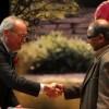 Dean Charles Edwards congratulates professor Rahul Parsa