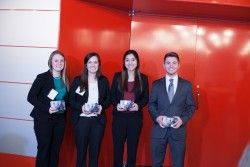 Students from Drake University Alyssa Mougin (left) and Joey Gale (right), with their Creighton teammates accept the runner-up award in this year's Murphy Cup strategic marketing competition.
