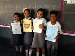 USA National Honor Society students researched, illustrated and bond books for students in Belize.