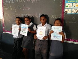 Books created for Belize students include topics such as the human body, animals and planets.