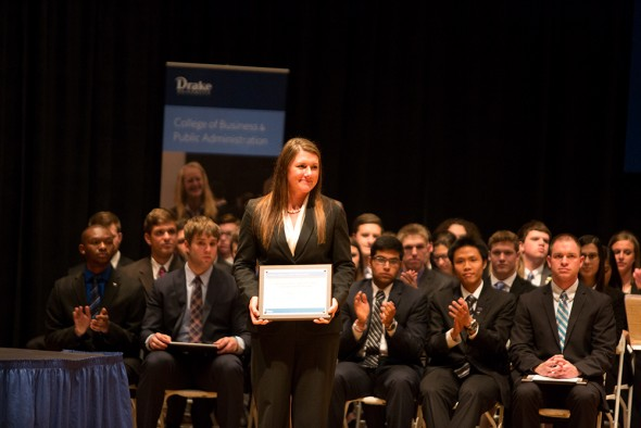 Kathryn Clausen of Hinton, Iowa, receives the Junior Student of the Year Award from the Drake University College of Business and Public Administration.