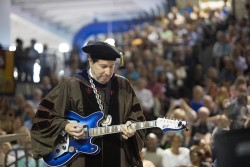 President Maxwell performs at spring 2015 commencement on a custom guitar created by Bilt Guitars of Des Moines.