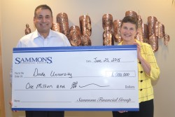 Esfand Dinshaw, Chairman and Chief Executive Officer for Sammons Financial Group, presents a $1 million check to Therese M. Vaughan, Ph.D., Dean, College of Business and Public Administration at Drake University, to fund the Sammons Endowed Professorship in Actuarial Science.