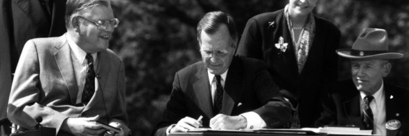 President Bush signs the Americans with Disabilities Act on July 26, 1990.