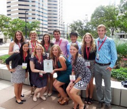 Members of Drake's Kappa Psi chapter pose with a national award presented to them at the at the 2015 Grand Council Convention in Denver, Colorado.