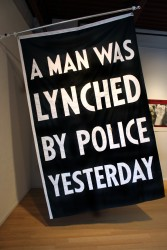 "Dread Scott, ""A Man Was Lynched By Police Yesterday."" Photo courtesy Moberg Gallery, Des Moines, July 2015."