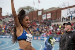 Track star Queen Harrison celebrates a Drake Relays victory.