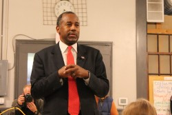 Ben Carson answers a few questions for an an overflow audience that included several Drake University students at Northside Cafe in Winterset, Iowa. / Photo courtesy www.iowacaucusproject.org