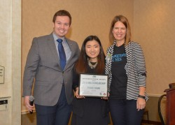 Drake junior Eunice Chang (center), recipient of the 2015 Iowa AMA Scholarship, poses with Tom Florian, director of collegiate and member relations for the Iowa AMA, and Iowa AMA President Kendra Kelly.