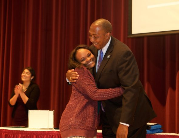 Brytani Cavil, senior marketing major in the College of Business and Public Administration at Drake University, hugs Dean of Students Sentwali Bakari during the Adams Leadership Convocation on Friday, April 22. Cavil, a single mother of two, was named Drake's top senior and will speak at the 140th Undergraduate Commencement Ceremony on May 15.