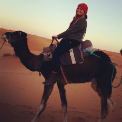 Taylor Donaldson rides a camel in the Sahara Desert while studying abroad in Morocco for the spring 2014 semester. Donaldson is one of two Drake students to receive a Fulbright Scholarship this year; she will teach English in Morocco.