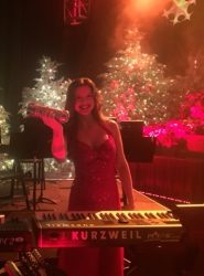A photo of Anna Lackaff, adjunct instructor of music at Drake University, who will tour the country as keyboardist for Mannheim Steamroller this holiday season.