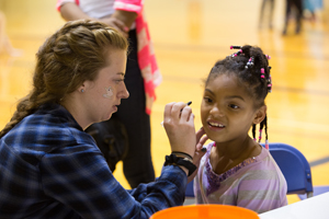 Girl participates in face-painting