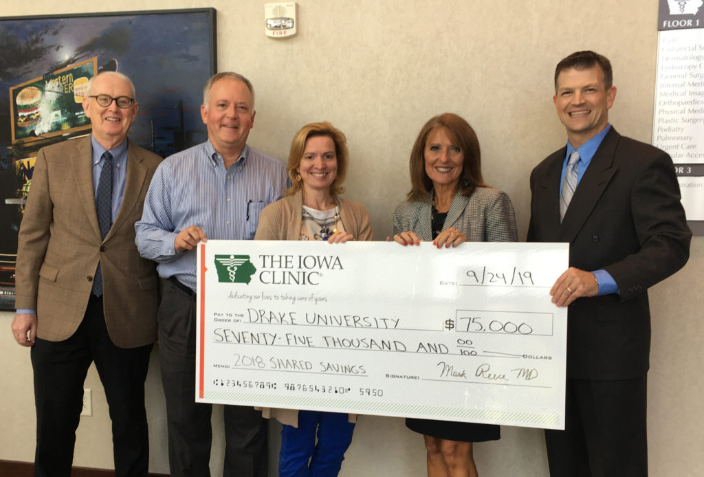 The Iowa Clinic presented Drake with a check of $75,000 as part  of a shared revenue savings. Pictured L to R: Kevin Cunningham, MD, Chief Medical Officer; Dr. Mark Reece, MD, FACS, Interim Chief Executive Officer; Christina Taylor, Chief Quality Officer; Renae Chesnut, Drake CPHS Dean; Mike Daly, Drake Associate Professor of Pharmacy Practice